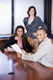 Multiracial businesspeople working on report Royalty Free Stock Photography