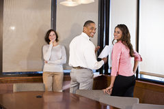 Multiracial businesspeople working on report Stock Photos