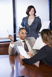 Multiracial businesspeople working on report Stock Image