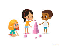 Multiracial children build tower with pink blocks. Kids play using kit