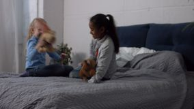 Multiracial children playing plush toys at home stock video footage
