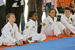 Multiracial children sitting on the mat Royalty Free Stock Images