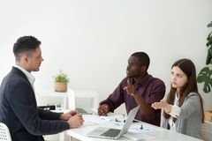 Multiracial colleagues disputing with coworker asking him to lea royalty free stock images