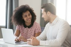 Free Multiracial Company Members Sitting At Desk Talking And Smiling Royalty Free Stock Photography - 160747457