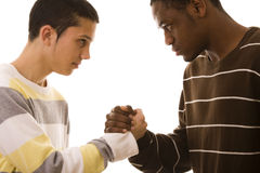 Multiracial confrontation. Multiracial face to face confrontation  (isolated on white Royalty Free Stock Image