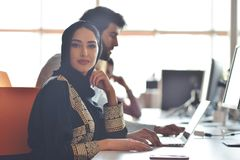 Multiracial contemporary business people working connected with technological devices like tablet and laptop stock photos