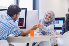 Multiracial contemporary business people working. Together in modern office Stock Image