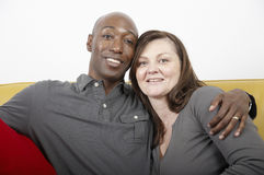 Multiracial couple. Husband and wife sit together in a hug Royalty Free Stock Image