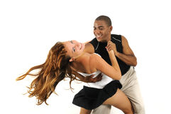 Multiracial couple dancing isolated Stock Photos