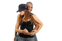 Multiracial couple in dancing pose Royalty Free Stock Images