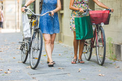 Multiracial couple of friends with bikes. Stock Image
