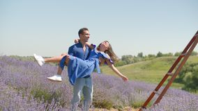 Multiracial couple having fun in lavender field stock video footage