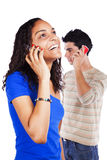 Multiracial couple holding cellphones Stock Photos