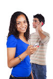 Multiracial couple holding cellphones Stock Photography