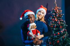 Multiracial Couple in love having fun and spending Christmas together royalty free stock photography