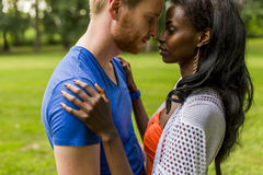 Multiracial couple in the park Royalty Free Stock Image
