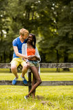 Multiracial couple in the park Stock Images
