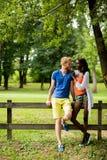 Multiracial couple in the park Stock Photos