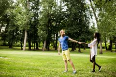 Multiracial couple in the park Royalty Free Stock Images
