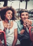 Multiracial couple riding on a sightseeing bus Royalty Free Stock Photo