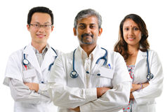 Multiracial doctors. / medical team crossed arms standing on white background Royalty Free Stock Image