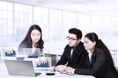 Multiracial employees and financial chart Royalty Free Stock Images