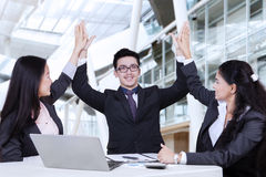 Multiracial employees raising hands up Royalty Free Stock Photo