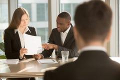 Multiracial employers making hiring decision, discussing resume,. Multiracial employers or recruiters making hiring decision, discussing resume while job stock photos