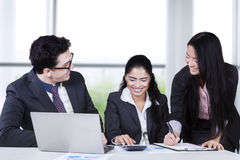 Multiracial entrepreneurs work in the office Stock Image