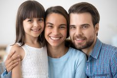 Multiracial family with little daughter looking at camera royalty free stock photos