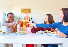 Multiracial female friends having fun in restaurant Stock Photo