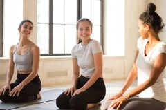 Multiracial females communicating together at sports training stock image
