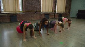 Multiracial females exercising with stability balls