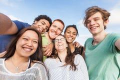Multiracial Friends at Beach Stock Photos