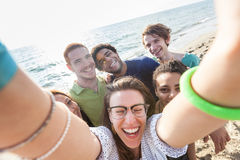 Multiracial Friends at Beach. Multiracial Group of Friends Taking Selfie at Beach royalty free stock images