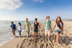 Multiracial Friends at Beach Stock Images