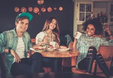Multiracial friends in a cafe Stock Image