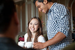 Multiracial friends with girl smiling 2 Stock Image