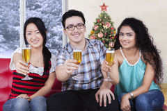 Multiracial friends holding champagne Stock Photography