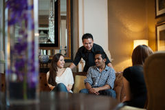 Multiracial friends in lounge Royalty Free Stock Photo