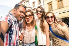 Multiracial friends taking selfie at city tour - Happy friendship concept with gen z student having fun together - Millenial. People on peace love concept royalty free stock images