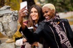 Multiracial friends taking selfie outdoor Stock Image