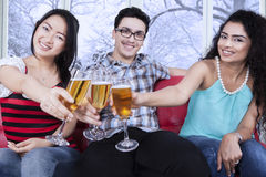 Multiracial friends toast with beer Stock Photography
