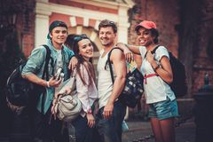 Multiracial friends tourists in an old city Royalty Free Stock Photo