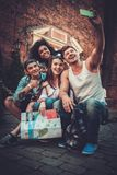 Multiracial friends tourists in an old city Royalty Free Stock Images