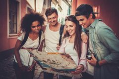 Multiracial friends tourists in an old city Royalty Free Stock Photos