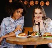 Multiracial girls in a cafe Stock Photos