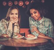 Multiracial girls in a cafe Stock Images