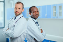 Multiracial group of doctors in medical uniforms in clinic. Portrait of multiracial group of doctors in medical uniforms in clinic Stock Photography