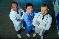 Multiracial group of doctors standing in row in clinic. High angle view of multiracial group of doctors standing in row in clinic Royalty Free Stock Image